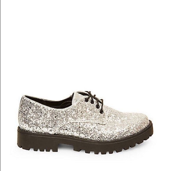 Steve Madden Silver Glitter Dewwars Add an unexpected twist to your outfit with these magic little silver glitter oxfords by Steve Madden. 1.25 inch heel height. These have never been worn and fit true to size! Steve Madden Shoes
