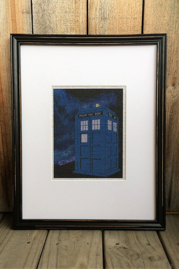 Police call box (TARDIS) print on burlap. The background is original art. Doctor Who.