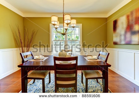 Green craftsman large dining room with cherry floor. by Artazum, via ShutterStock