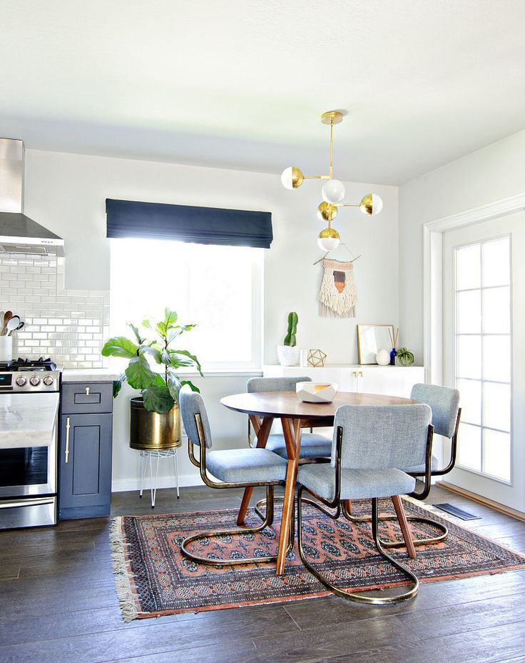 Modern midcentury dining space with pale blue chairs