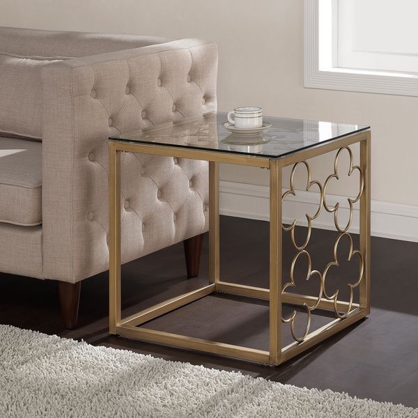 Bring a hint of contemporary glamour into your living area with this metal and glass end table. Crafted with a sturdy frame in a gold finish, the metal and glass end table gleams gently in any light,