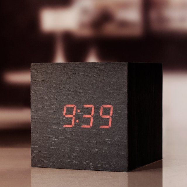 """SimpleWooden Alarm Clock Box by Kikkerland. Clap your hands to make the red LED time appear. 2 AAA batteries (NOT included). L 3.5"""" x W 3.5"""" x H 3.5"""" Please allow 7-10 days for delivery."""