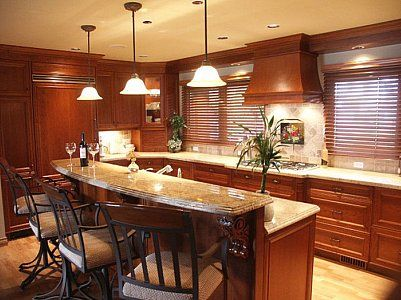 images of kitchen islands with two levels | using a different countertop material or color to create a focal point ...