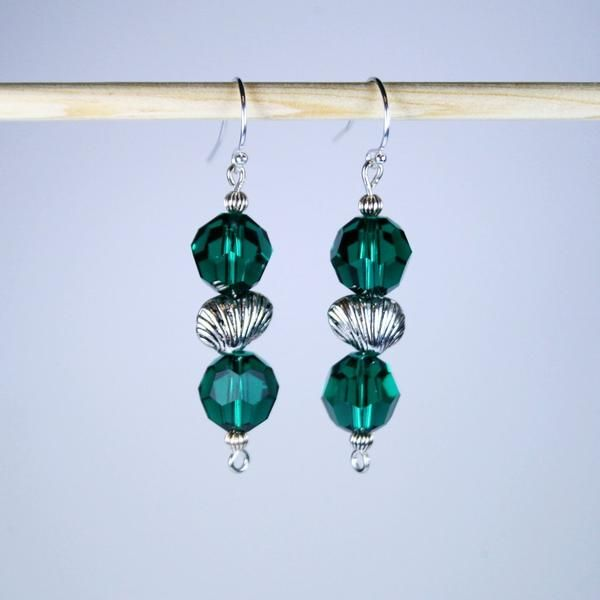 eb49abaf06e6 Striking Swarovski Emerald Green Earrings in Faceted 10mm Round Crystals  with an Antique 925 Sterling Silver Plated Sea Shell in the center.