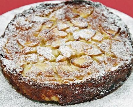 More like a flan than a cake, this rustic dessert is chock-full of apples and incredibly moist, making every spoonful a pure delight. The list of ingredients is short, and for good reason: it's all about the apples!The delectable apples in this recipe can be cut into super-thin slices easily by using the slicing attachment of a food processor, although a mandoline or a box grater will do the job perfectly, too.