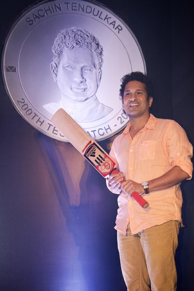 Sachin Tendulkar unveils Collector's Edition Silver Coins. Indian cricketer Sachin Tendulkar poses before a picture of the silver coin with his face embossed on it along with the number of Tests he has played.