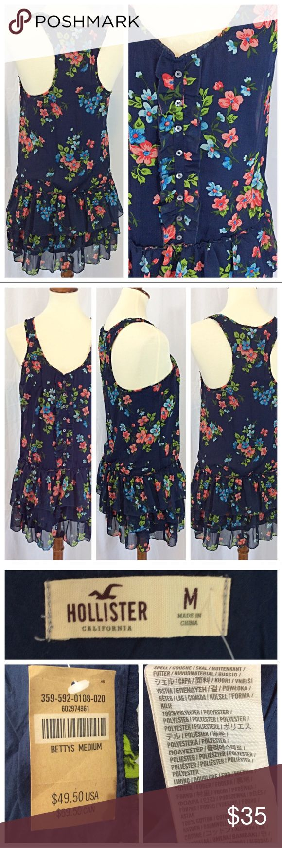 """NWT - Hollister Floral Ruffle Dress Super cute flirty summer dress with playful ruffles, all in a fun floral pattern. Sleeveless with racerback design, layers of ruffles below waistline. Fully lined for completeness. Size M, 17.5"""" chest when laying flat, 34"""" total length. Excellent unworn condition Hollister Dresses"""