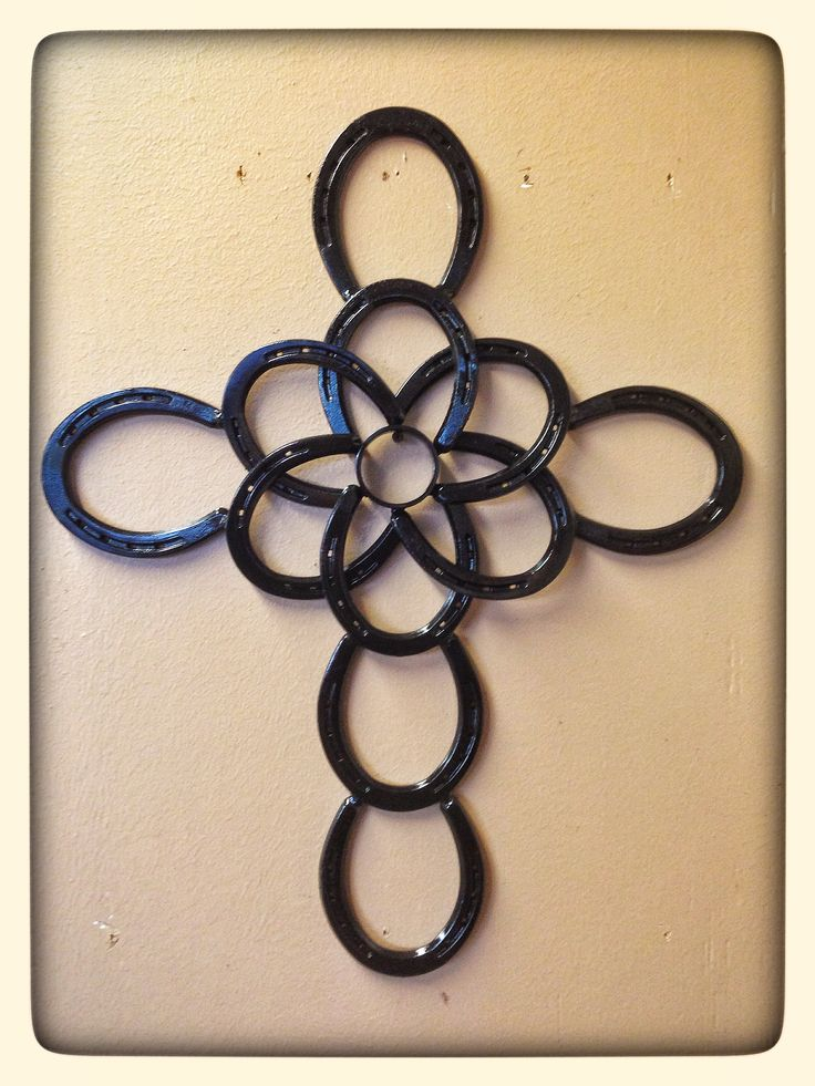 "Large cross with circle center 25""X20"" $75"