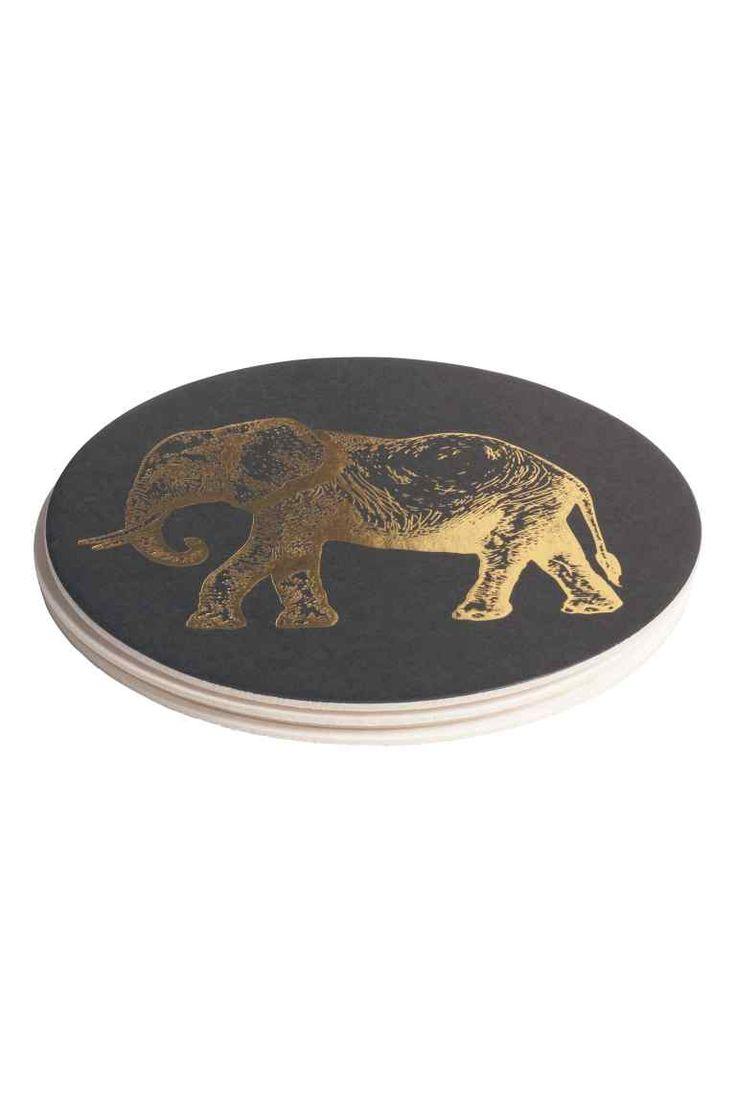 Bases para copos, pack de 4: Bases para copos em cartão com estampado dourado. Diâmetro: 10 cm.