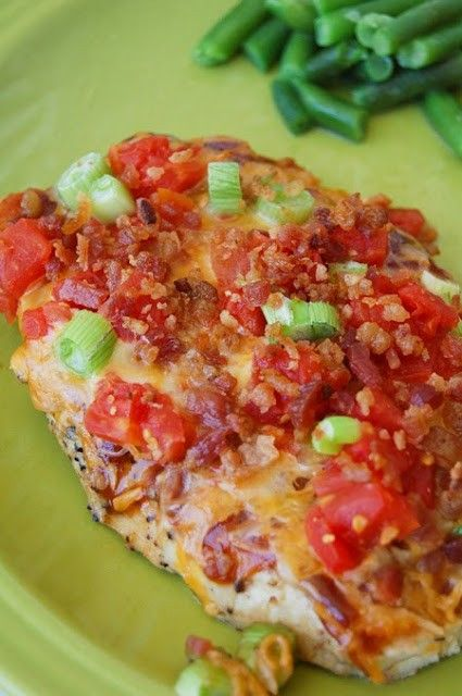 Ingredients    4 boneless, skinless chicken breasts  1/4 c. bar-b-que sauce ( I use Bull's Eye)  1/4 c. real bacon bits  1 c. colby and jack cheese, shredded  1 14 oz. can Rotel tomatoes, drained (canned with green chilies added)  sliced green onions  pepper