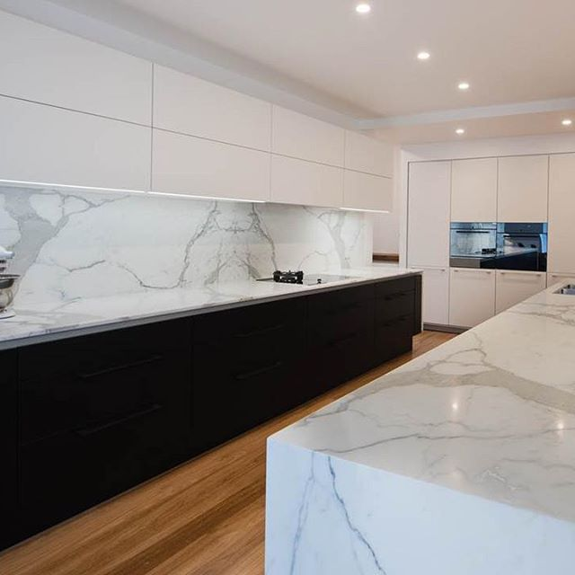 Gorgeous Calacatta marble benchtops and splashback, add impact and style to any kitchen.