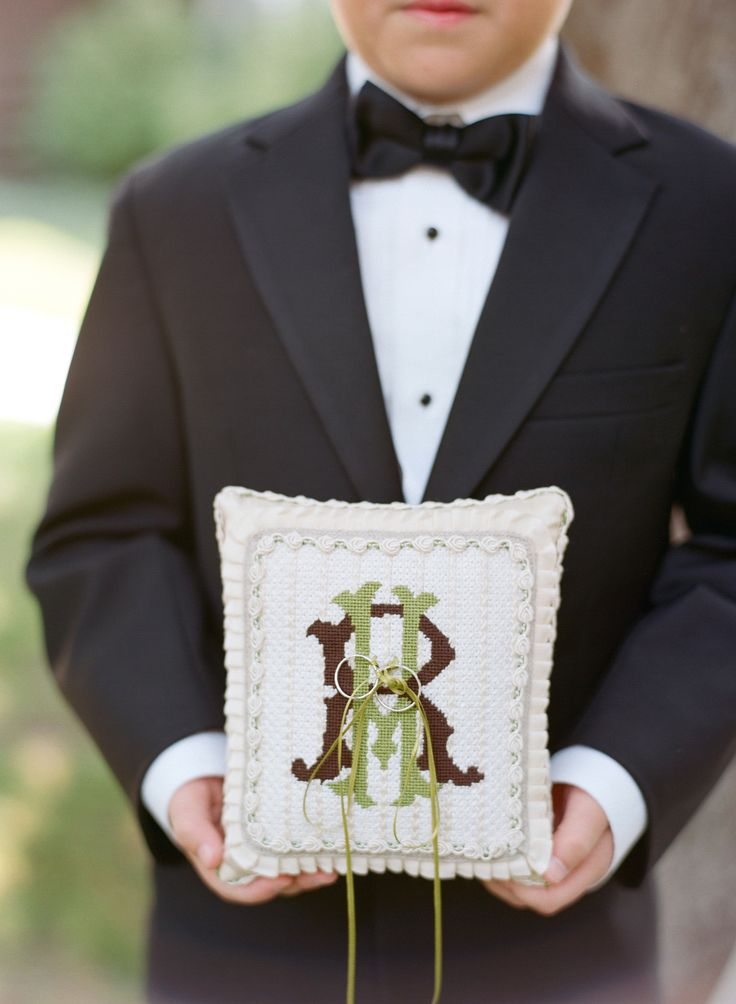 Needlepoint Monogrammed Ring Pillow - Photography: CarriePattersonPhotography.com: | A monogram theme wedding - 15 Ways to Use Monograms : https://www.fabmood.com/monogram-theme-wedding