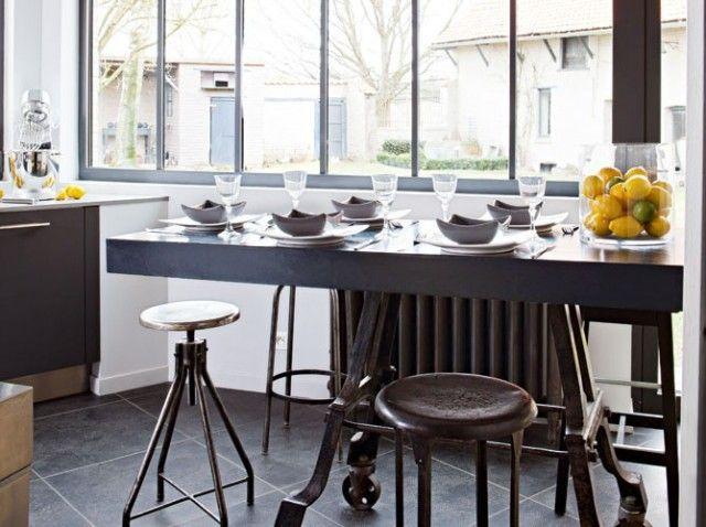 Cuisine industrielle dans une véranda / Industrial kitchen in a veranda---check out large floor tiles. Want.