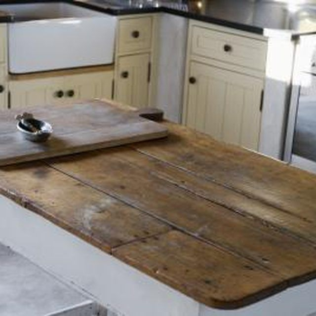 Give Formica tables a new life with a wood top.