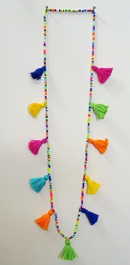 FREE SHIPPING! Tassels Necklace/Summer Boho multi seed bead necklace/ Multi coloured necklace.  Colourful & Vibrant Seed bead & Tassels necklace is just right for the summer wear. Try out this light weight Necklace to the Beaches or to the Summer outing. Wear it single or in multiples. Even it can be worn as multi wrapped bracelet(see picture) Price is for a single Necklace.  ****************  MEASUREMENT:  Length : Approx.34 inches **************** SHIPPING :  Free Shipping...