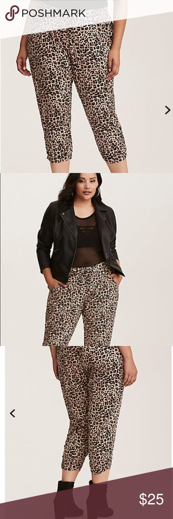 """Torrid Leopard Joggers Size 0 These are the fanciest jogger pants ever. Challis fabric lends effortlessness to the cropped pair, with a fierce leopard print lending me-owww appeal. The ruched leg helps to play up your proportions, while the smocked adjustable drawstring waistband handles your curves oh-so-comfortably. 23"""" inseamRayon/spandexWash cold, line dryImported plus size pants torrid Pants Track Pants & Joggers"""