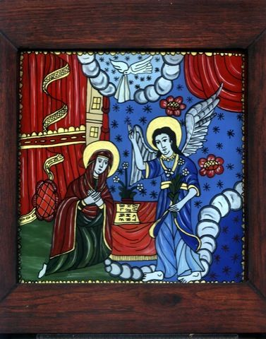 Glass icon, Romania '  Glass Icon representing the Anounciation SceneThe Museum of Painted Glass Icons Painting on glass has been a tradition for 200 years in the villages around Sibiu. In 1968, the founder of the museum, priest Zosim Oancea, started to collect 18th and 19th century icons richly painted on glass. Today, the museum exhibits the largest collection of painted glass icons in Europe - more than 700, as well as furniture and ceramics.