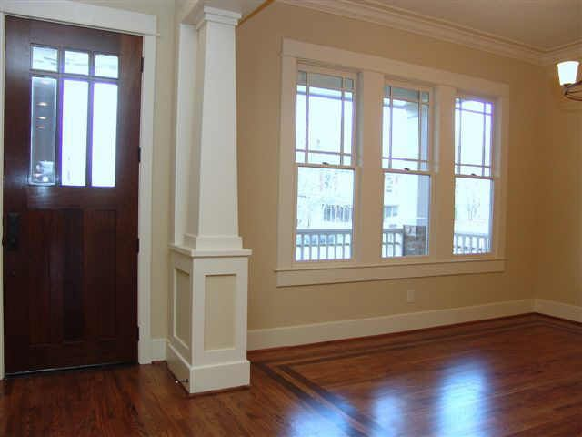 Open Foyer Windows : Dining open to foyer and living area with columns similar