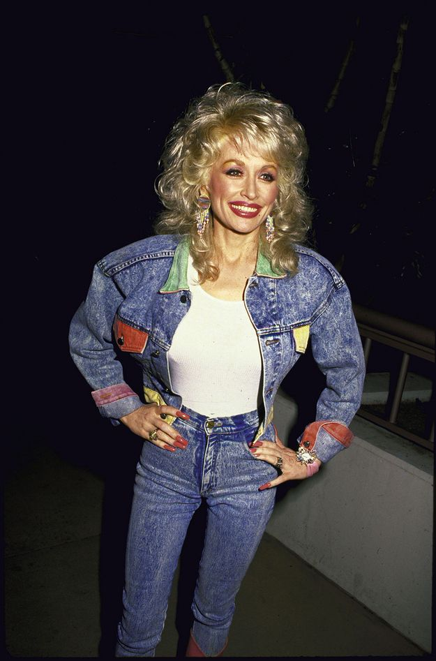 19 of Dolly Parton's Most Fanciful Sleeves: The cuffed acid-wash sleeves of this denim jacket are so unapologetically '80s.