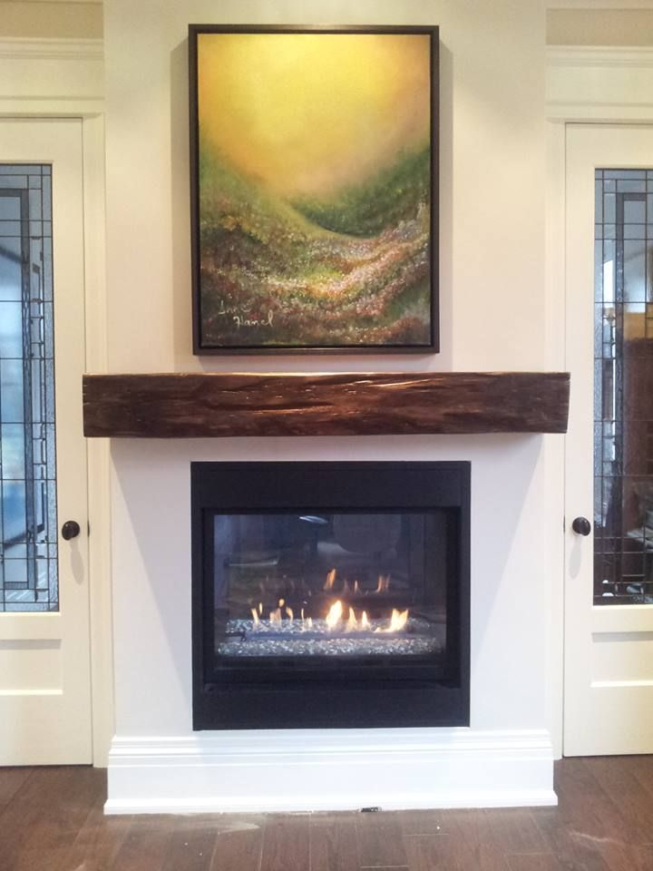 Our barn beam fireplace mantels can be planed and sanded to look more contemporary. Come check us out and find out why we are the leaders in the GTA for Fireplace Barn Beam Mantels. We custom cut to your measurements, we don't have pre-fab waiting with dust on it! We customize size, stain, color and sheen just for you! Now should we tell the owner a little to the right for his artwork?