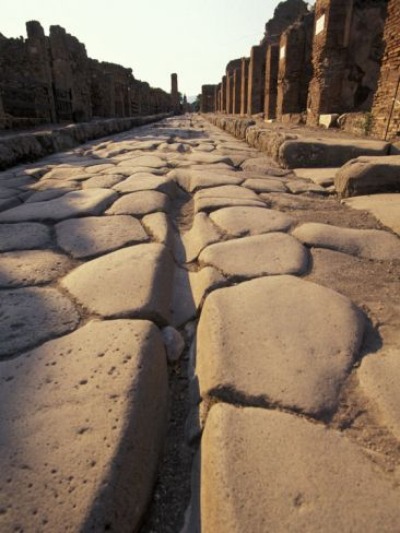 Close Up of a Chariot Rut in Ancient Roman Streets in Pompeii, Italy. This has always been one of my favorite photos.