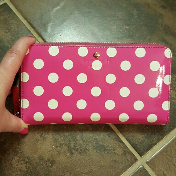 Kate Spade pink/white polka dot wallet Adorable bright pink and white polka dot wallet. Accordion style with plenty of room for credit cards, receipts, cash and an inside zipper pocket for change. The only flaws are shown in pic #3 and #4. EUC Kate Spade Bags Wallets