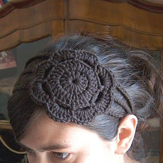 crochet headband with flower - Made this last night. Very easy and very pretty. Not sure if I can pull off the flower on my head look, but it's still really cute