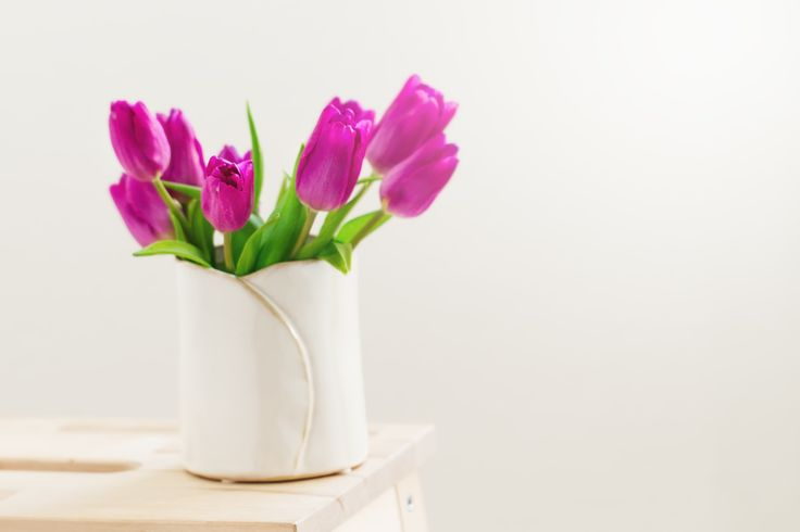 Beautiful Fresh Spring lila Tulips in Vase on bright background. - Beautiful Fresh Spring lila Tulips in Vase on bright background. Spring, easter or Mother's Day Concept.