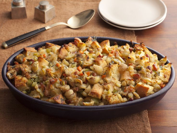 Ciabatta Stuffing with Chestnuts and Pancetta : For Giada's Italian-style Thanksgiving, she makes stuffing with rustic ciabatta bread mixed with sauteed vegetables and salty pancetta. The earthy chestnuts and savory Parmesan cheese make the dish extra special.