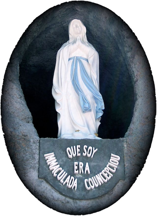 "Is Immaculate Conception a Holy Day of Obligation?: A statue of the Blessed Virgin Mary as she appeared at Lourdes, France, in 1858, where she announced, ""I am the Immaculate Conception."" Shrine of the Most Blessed Sacrament, Hanceville, Alabama."