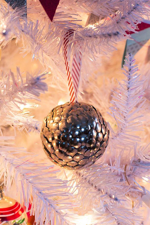 Use thumbtacks and a styrofoam ball to create stylish Christmas ornaments.