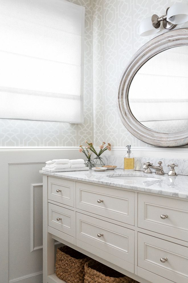 This Calming White And Gray Bathroom Features Upper Walls Clad In Gray  Trellis Wallpaper And Lower Walls Clad In Wainscoting Lined With A White  Freestanding ...
