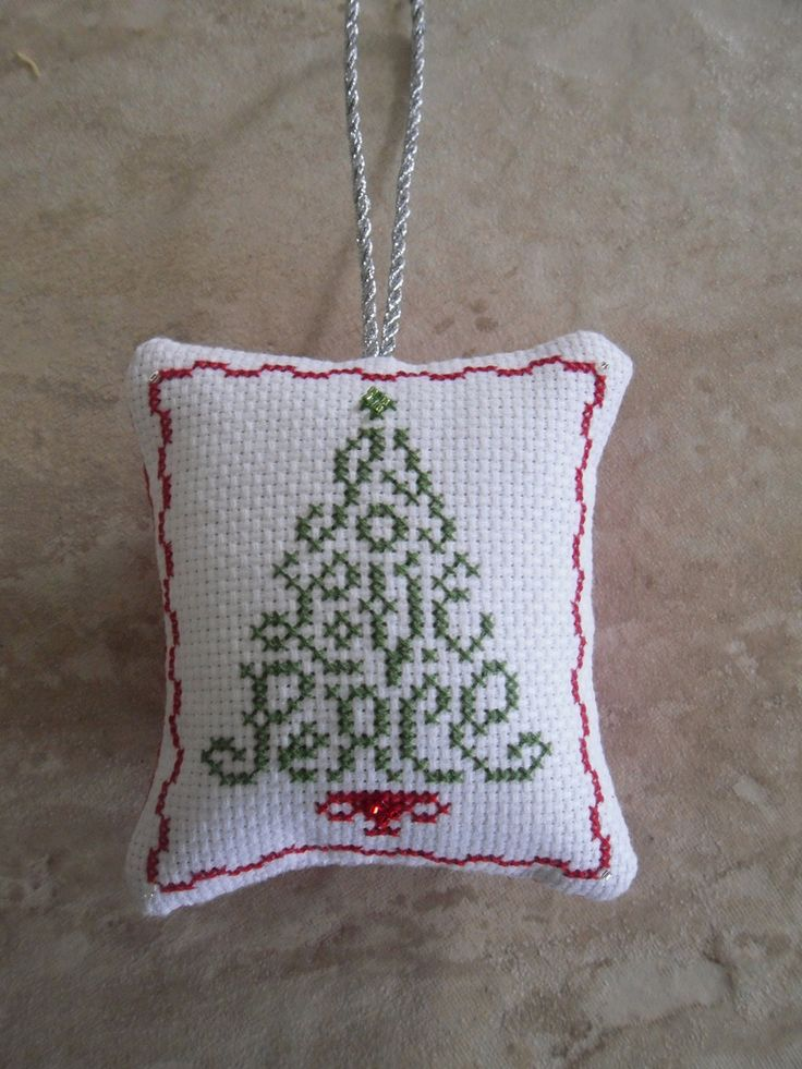 https://flic.kr/p/7kBJkk | Cross Stitch Christmas Tree Ornament #1 | Love this pattern by Judy Whitman (JBW Designs)...stitched up very quickly, and I added a few transparent silver lined glass delica beads for some shimmer, and sewed a piece of red aida onto the back along with the silver cording to make it into a pillow ornament.