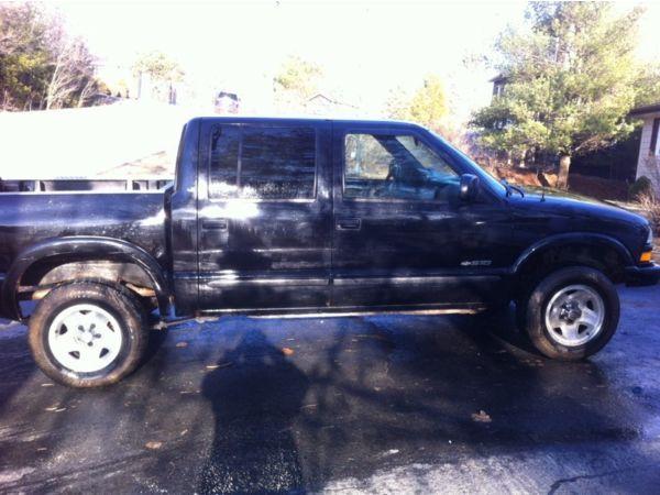 black lifted chevrolet silverado truck