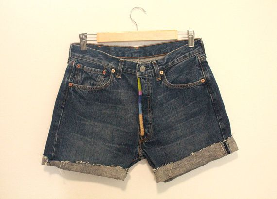 Vintage Levi's high waist jean shorts with handmade colorful patch work in front!