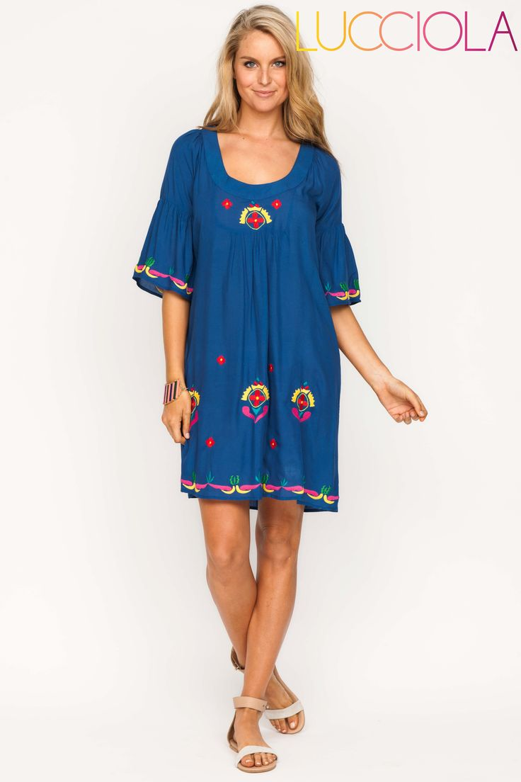 Boho style dress, above the knee  with scoop neck line, elbow length sleeves and embroidery