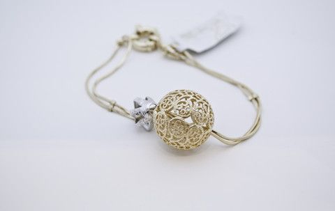 Elevate your modern day look with a beautifully handcrafted #bracelet. Mires Brandao's bracelet adds a touch of silver with the crown and includes a patterned flower ball.  Approximate length: 7 1/2 inches.