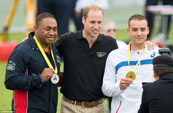 Prince William with Team GB's Derek Derenalagi, who won silver medal in the 100m Ambulant IT2. Right is winnerRobert Phillipe of France  ~~ September 11, 2014