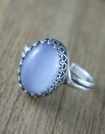 I must find this ring.. Moonstone is my stone.. This is beautiful..!!  Light blue moonstone Glass Ring