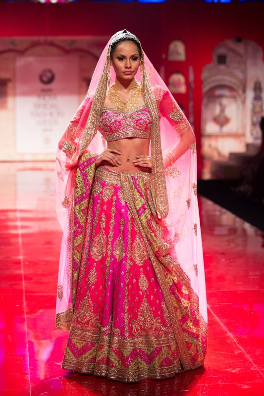 Hot pink and gold heavy Indian wedding lehnga by Suneet Varma. More here: http://www.indianweddingsite.com/bmw-india-bridal-fashion-week-ibfw-2014-suneet-varma/