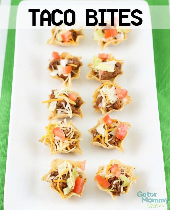 Taco Bites are an easy bite-size appetizer for parties. They are a great snack for a football party. These mini tacos are served in TOSTITOS:registered: Scoops and topped with taco seasoned ground beef and toppings: Mexican cheese, lettuce, onions and tomatoes. #GameDayGlory #ad #CollectiveBias - Taco Bites Recipe on Gator Mommy Reviews