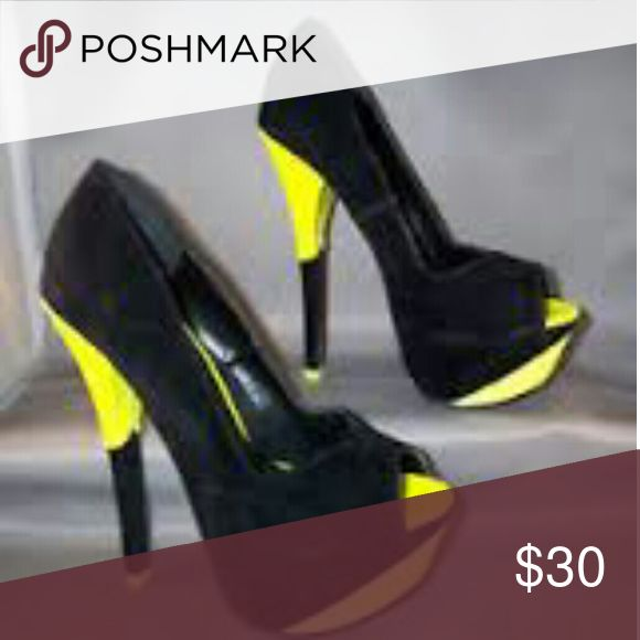 SHIEKH WOMEN'S HIGH HEEL PUMP Flattering stand-out black and neon high heels from the Shiekh?Shoes?collection.  Vegan leather/patent Styled V-cut Peep toe Semi-hidden platform Stiletto heel Padded insole Partially wrapped heel Durable outsole Lining: man-made Heel height: 6 in. Platform height: 2 in. Size 5.5 SHIEKH Shoes Heels