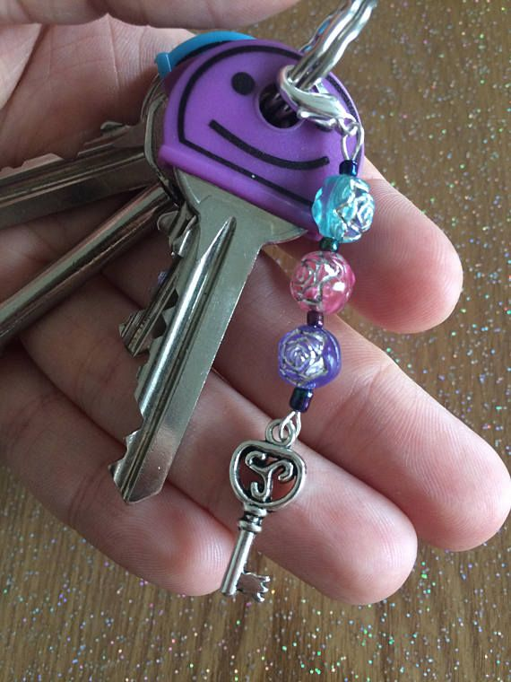 This unique keyring charm has been crafted to add a touch of colour and beauty to your keys or bag.  - Approximately 7cm long - Attaches by a 10mm lobster clasp  It is also perfect to give as a beautiful gift to your best friend, a partner or a family member. Would do well for birthdays, celebrations and as a stocking filler.