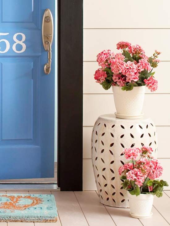 Strike a Balance.. soften it with seasonal flower's and neutral flower pots.