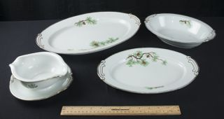 CRAFTSMAN CHINA, MADE IN JAPAN IN PIONEERS PINE CONE PATTERN. INCLUDES GRAVY BOAT WITH 3 LARGE SERVING DISHES.