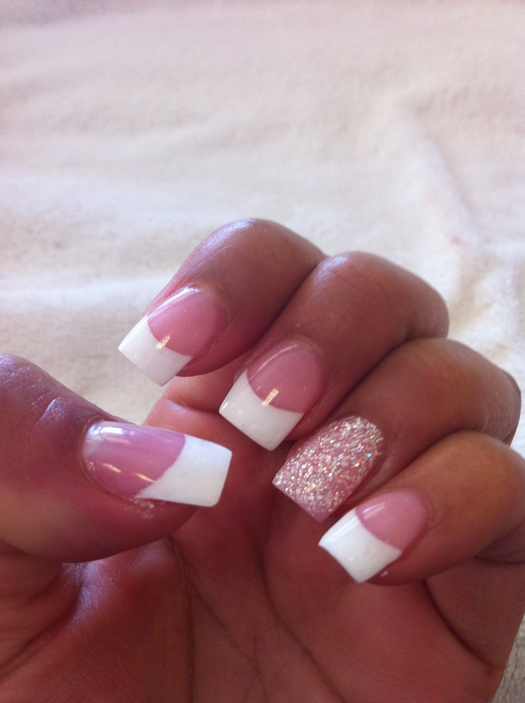 French tip nails with design on ring finger
