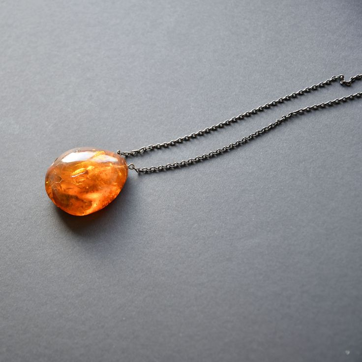 WEIGHT: 22 g. DESCRIPTION: This pendant was made more than 50 years ago - its bright red natural color tells of its age.