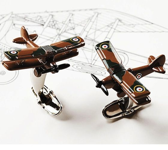 Smithsonian Biplane Cufflinks / These are perfect cufflinks for aviation buffs, featuring a couple of retro biplanes honoring Charles Lindberg's historic flight across the Atlantic. http://thegadgetflow.com/portfolio/smithsonian-biplane-cufflinks/