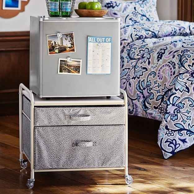 Put your mini fridge atop a fridge cart for extra storage. | 37 Ingenious Ways To Make Your Dorm Room Feel Like Home