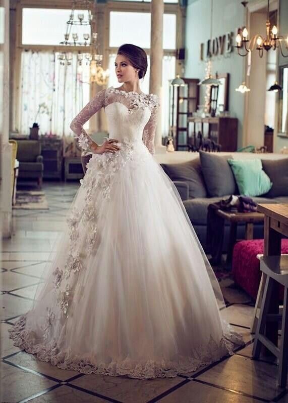 Absolutly in love with this wedding dress!! Lace flowers tulle ballgown and sweetheart neckline with sheer neck and sleeves. So perfect